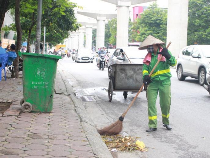 Tả công nhân vệ sinh đang làm việc